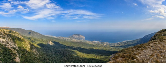 Panoramic landscape. View of the Yalta mountain-forest nature reserve, resort settlement Gurzuf. Mount Ayu-Dag 570 m high issued into the sea. Republic of Crimea.