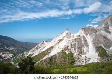 panoramic landscape of white marble quarries of Carrara in the Apuan Alps. Colonnata, Massa Carrara district. Tuscany, Italy