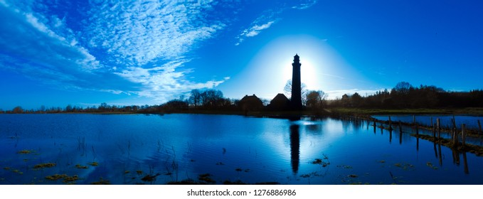 panoramic landscpae with Lighthouse in Behrensdorf in contre jour twilight