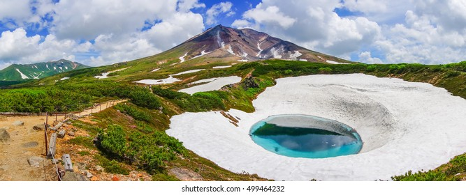 Panoramic Little blue pond with snow and walkway in Asahidake mountain, Daisetsuzan National park, Asahikawa, Hokkaido, Japan