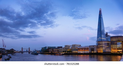 Panoramic London skyline with The Shard skyscraper located on the south bank of the River Thames in  Southwark as viewed from the London Bridge at night