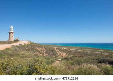 Panoramic lookout view along coast of Ningaloo Reef, Cape Range National Park, Exmouth, Western Australia, with Vlamigh Head Lighthouse,  sunny blue sky, copy space.