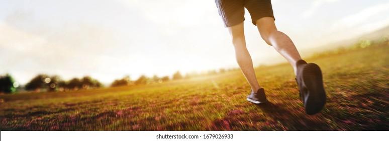 panoramic - man running marathon through the field