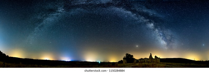 Panoramic milky way and old castle with mars and saturn