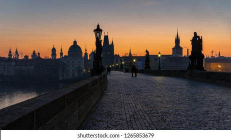 Panoramic morning view along Charles Bridge towards Old Town - Prague, Czech Republic