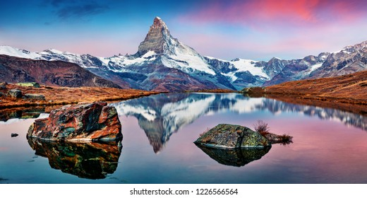 Panoramic morning view of Stellisee lake with Matterhorn / Cervino peak on background. Impressive autumn scene of Swiss Alps, Zermatt resort location, Switzerland, Europe.