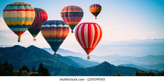 Panoramic of mountain with hot air balloons on morning at Thailand.
