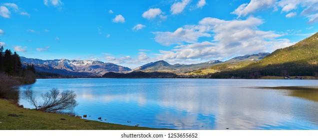 Panoramic mountain landscape of Hallstatt lake at sunny day in Austrian Alps, Salzkammergut region.