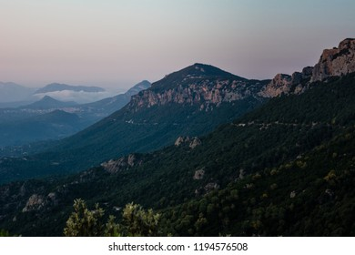 Panoramic Mountain Landscape view after a beautiful sunset, with layered blue mountains, Sardinia, Orosei region.