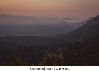 Panoramic Mountain Landscape view after a beautiful sunset, with layered lilac mountains, Sardinia, Orosei region.