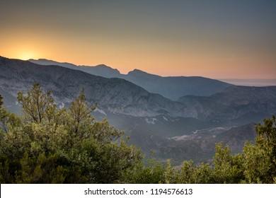 Panoramic Mountain Landscape view during a beautiful sunset, with layered blue mountains, Sardinia, Orosei region.