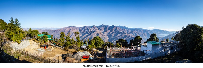 Panoramic mountain range view from Mussoorie city situated in Uttarakhand, India. Natural landscape of barren mountains in Dehradun. Travel photography in Uttarakhand. Blue mountains in India. - Image