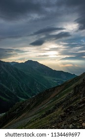 The panoramic mountain view with rocks and ice in Tian Shan mountains in Central Asia near Almaty covered by dramatic sunset clouds. Best place for active life, climbing, hiking and trekking.