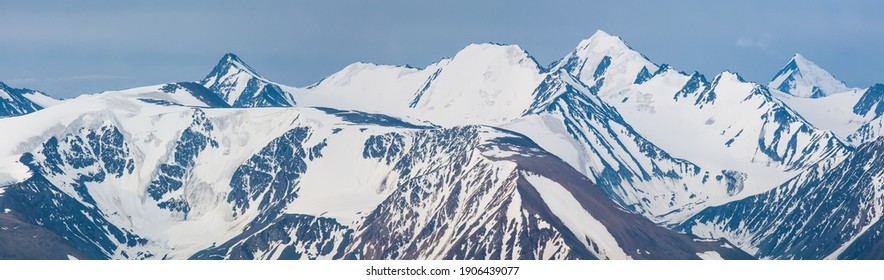 Panoramic mountain view. Snow-capped peaks and glaciers.