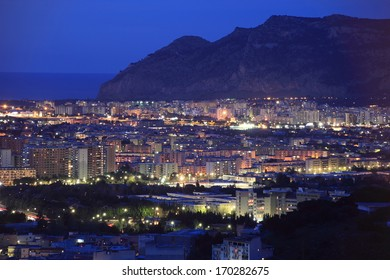 panoramic night cityscape of Palermo facing the Mediterranean sea in Sicily, Italy