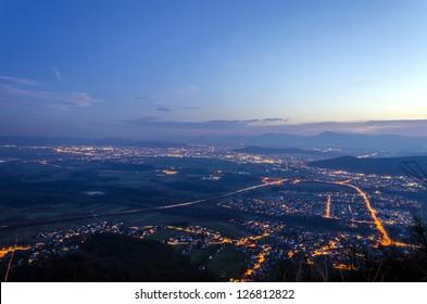 Panoramic night view on Ljubljana from top of Smarna mountain.