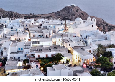 """Panoramic night view of Plaka village (""""capital"""" of Milos island) and the bay of Milos, Cyclades, Greece"""
