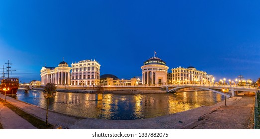 Panoramic night view of Skopje City Center at evening. Architecture and buildings of Skopje City - the capital of the Republic of Macedonia (FYROM). Balkan Peninsula. Southeast Europe