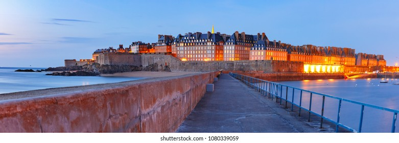 Panoramic night view of walled city Saint-Malo with St Vincent Cathedral, famous port city of Privateers is known as city corsaire, Brittany, France
