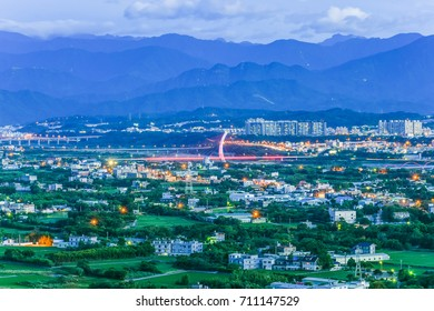 Panoramic Night View of Zhubei City With Rice Fields and Modern Buildings from The Peak of LiTo Mountain , Hsinchu, Taiwan