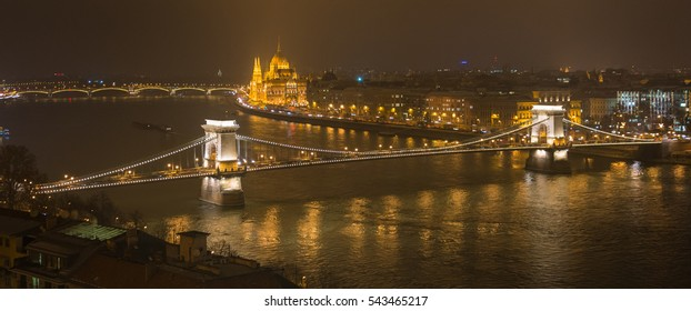 Panoramic night winter view of Chain Bridge and Parliament in Budapest, Hungary, December-21-2016