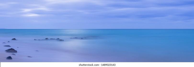 panoramic ocean night view in the moonlight, long exposure