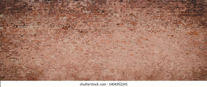 Panoramic Old messy Brick Wall Background. Vintage Brick Texture. Wide Angle Web banner or Wallpaper With Copy Space for design.
