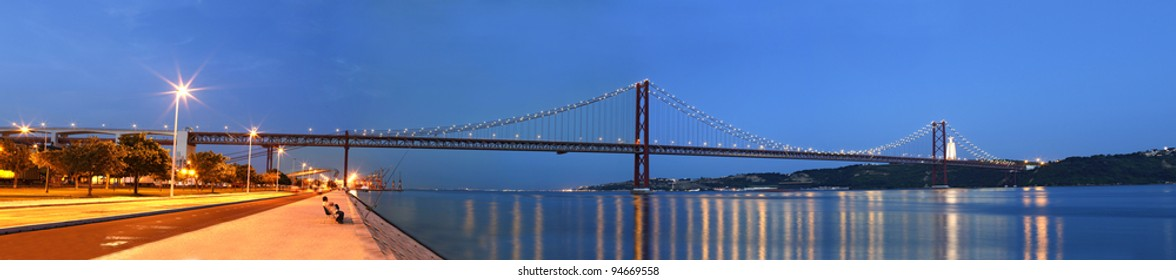 Panoramic over the city of lisbon where you can see the tagus river, the bridge, the other side of the river, big christmas tree, the downtown and the historical part of the city