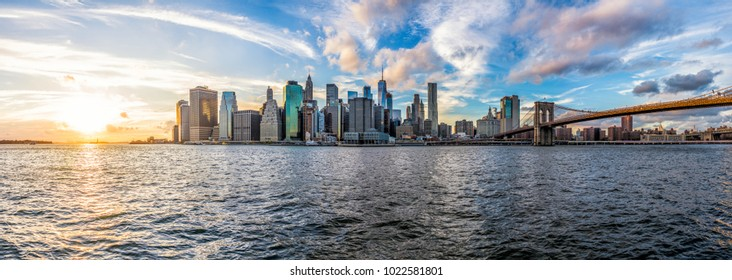 Panoramic Panorama view of outside outdoors in NYC New York City Brooklyn Bridge Park by east river, cityscape skyline during sunset