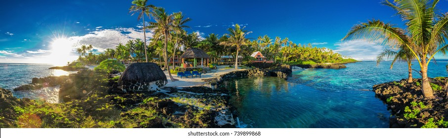Panoramic paradise holoidays location with coral reef and palm trees on south side of Upolu, Samoa Islands.