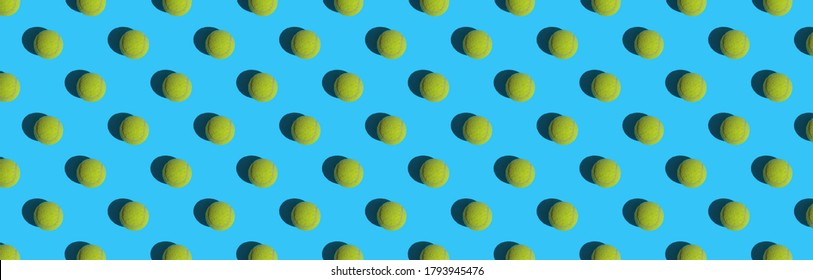 Panoramic pattern of tennis balls on blue paper. Can be used as a background.