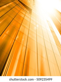 Panoramic and perspective wide angle view to steel light gold background of glass high rise building skyscraper commercial modern city of future. Business concept of success tech industry architecture