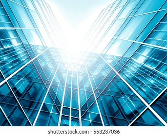 Panoramic and perspective wide angle view to steel light blue background of glass high rise building skyscraper commercial modern city of future. Business concept of success industry tech architecture