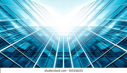Panoramic And Perspective Wide Angle View To Steel Light Blue Background Of Glass High Rise Building