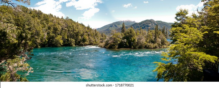 Panoramic photo of blue lake and mountains