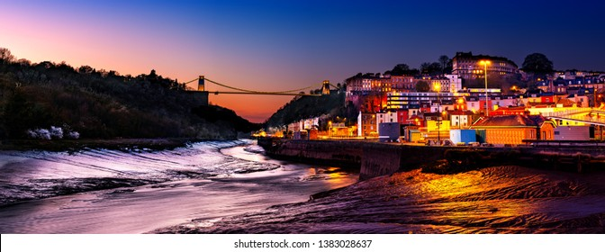 Panoramic photo of Clifton Suspension Bridge over the river Avon and Clifton Village, Bristol, England UK taken in the Blue Hour