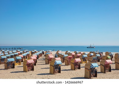 a panoramic photo of colorful beach chairs on the beach in beautiful weather