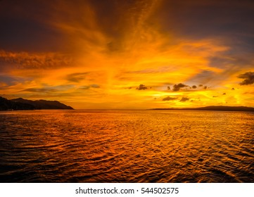 Panoramic photo of colourful sky and sea during sunset on Kri island in Raja Ampat, West Papua, Indonesia.