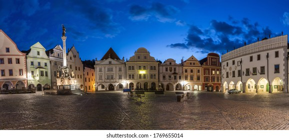 Panoramic photo of completly empty town square Svornosti (Namesti svornosti) in Cesky Krumlov in the evening. This place is usually full of tourists but covid-19 quarantine emptied the place totally