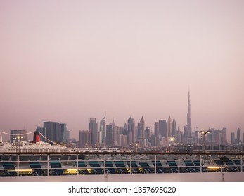 Panoramic photo of Dubai in the evening. View from a cruise liner. Concept of leisure and travel