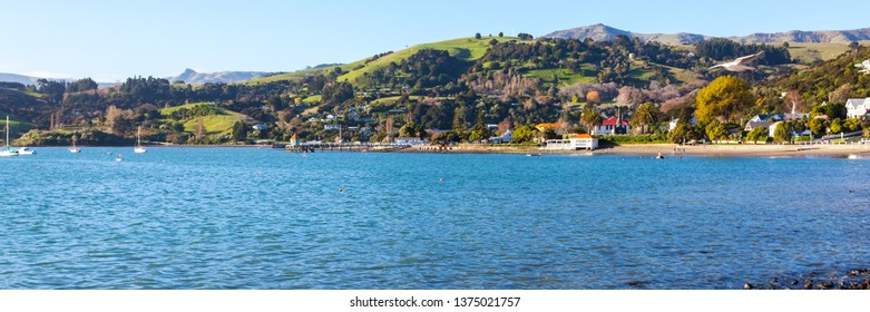 Panoramic photo of the harbour side in the French settlement town of Akaroa in the South Island of New Zealand.