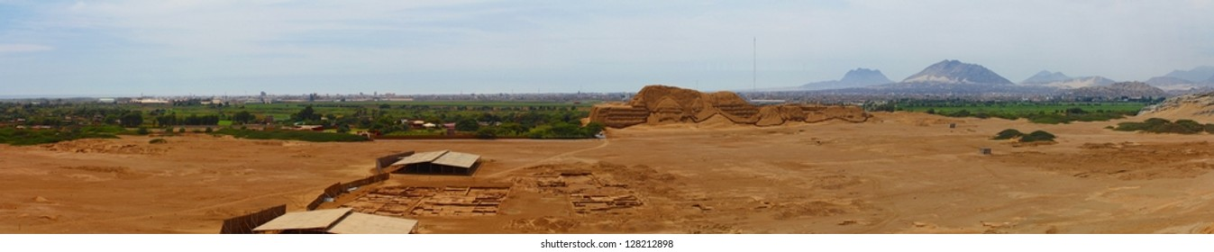 Panoramic photo of Huaca del Sol and archaeological excavations. This photo is made attaching together various photos