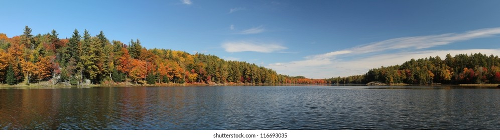 Panoramic photo of lake and autumn forest in Killarney Provincial Park, ON, Canada. This photo is made attaching together various photos
