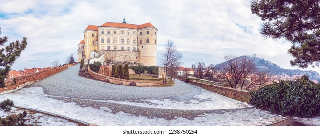 Panoramic photo of Mikulov castle and holy hill, Czech republic. Travel destination. Beautiful place. Purple photo filter.