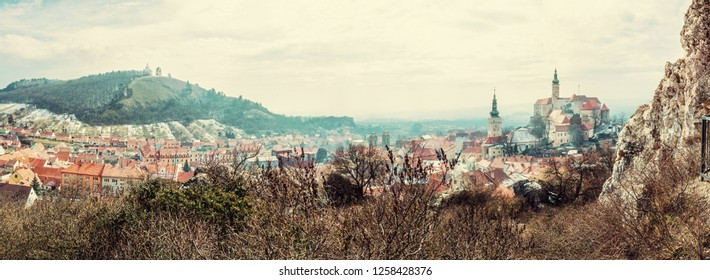 Panoramic photo of Mikulov with castle, holy hill and old town centre. Czech republic. Travel destination. Beautiful place. Beauty photo filter.