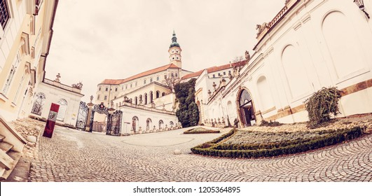 Panoramic photo of Mikulov castle, southern Moravia, Czech republic. Travel destination. Architectural scene. Red photo filter.