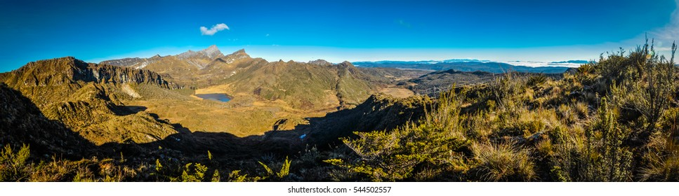 Panoramic photo of mountains and lake in distance during morning in Trikora, Papua, Indonesia. This is very remote location, rarely visited by people.