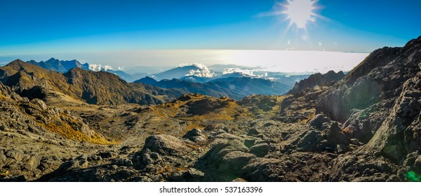 Panoramic photo of rocks and morning view at sunrise on Mount Wilhelm, Papua New Guinea.