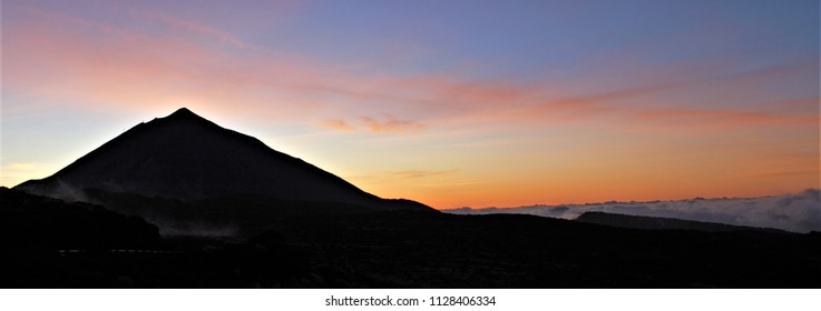 panoramic photo of the silhouette of the volcano el teide at dusk,, series of photographs of the volcano El Teide, in Tenerife, Canary Islands, Spain,