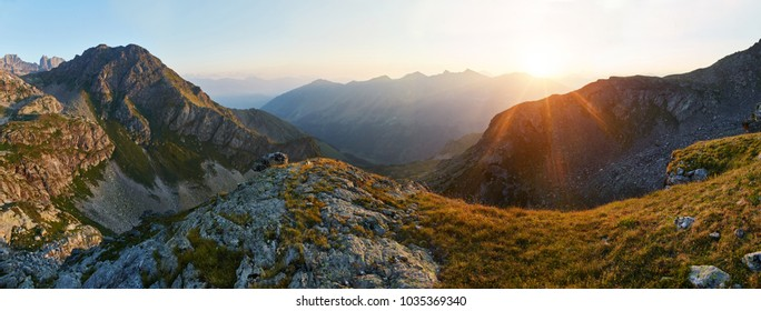 Panoramic photo of summer mountain valley of Arkhyz ridge, Russia, Caucasus. Fabulous sunrise and sunset in the mountains, amazing nature, summer in the mountains. Travel and hike